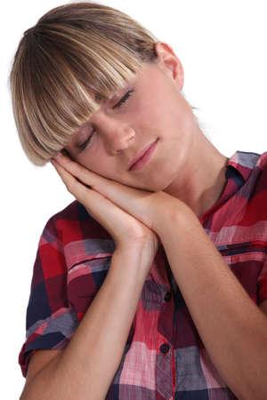 snoozing: A sleepy woman