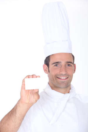 chefs whites: Chef with a blank business card