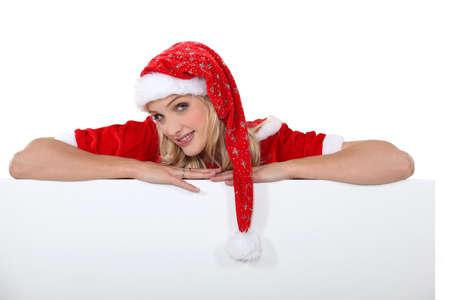 señora: Señora Santa con un tablero en blanco para su mensaje