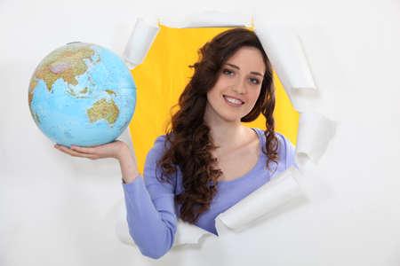 abroad: Woman holding globe Stock Photo