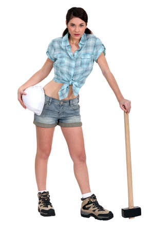 sordid: Attractive brunette posing with sledge-hammer Stock Photo