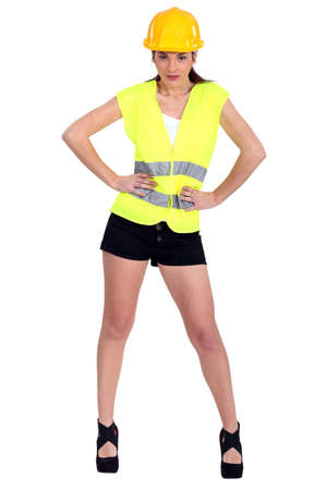 warning vest: Woman in a hardhat and hotpants