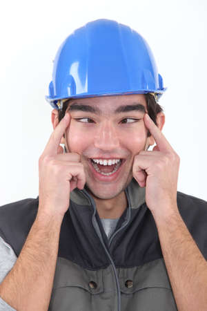 slant: head and shoulders portrait of European craftsman passing for Chinese Stock Photo