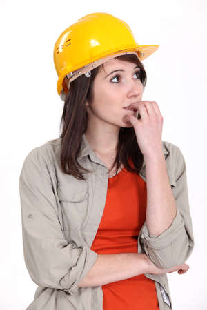 Nervous female builder photo