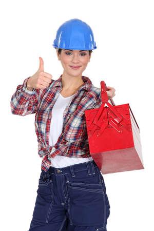 tradeswoman: Tradeswoman holding a toolbox
