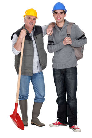 Experienced tradesman welcoming his new apprentice Stock Photo - 15411150