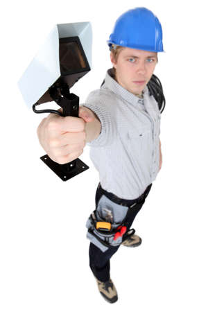 Electrician holding security camera photo
