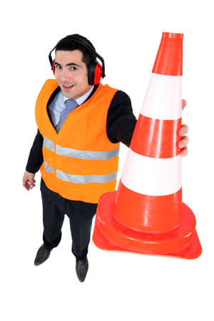 Man with ear cone showing signs photo