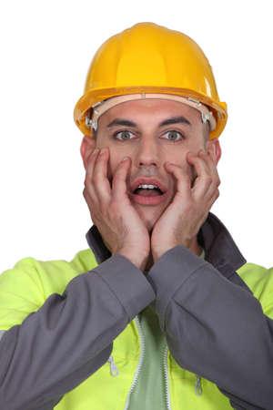 bewilder: Portrait of expressive building worker