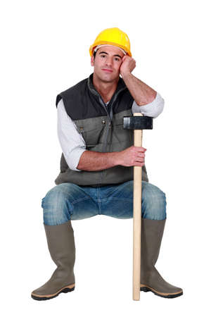 sledge hammer: Construction worker with a sledgehammer
