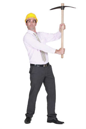 full-body portrait of architect holding pickaxe photo