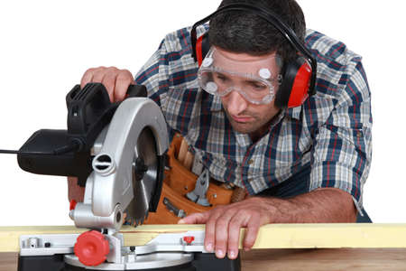 carpenter cutting wood photo