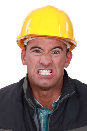 Angry builder grimacing photo