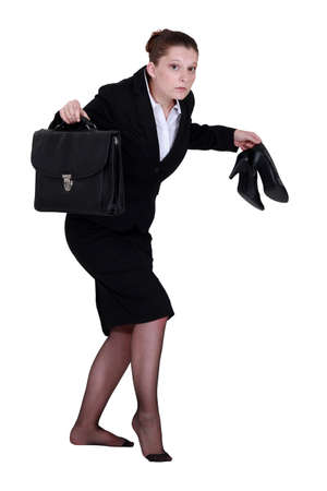 A businesswoman leaving quietly. photo