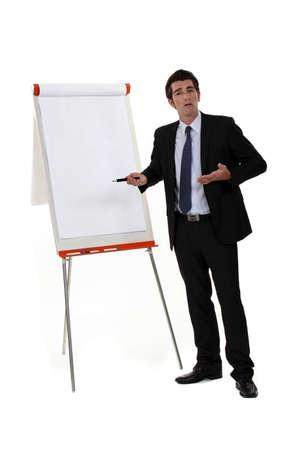 executive board: A businessman doing a presentation.