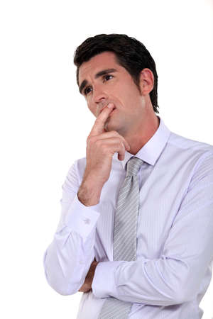 deep thought: Businessman deep in thought Stock Photo