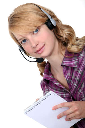 notecase: businesswoman with earphones and notepad Stock Photo