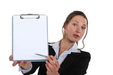 poll: Business professional pointing to a clipboard