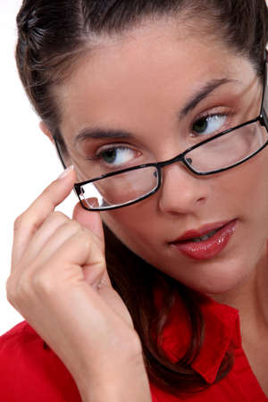 steamy: Woman seductively removing glasses