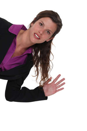 Businesswoman waving photo