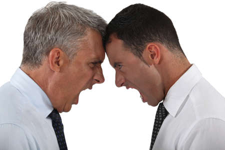 people arguing: Two businessmen having an argument