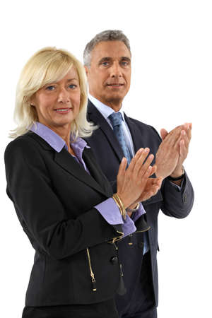 acclamation: Business professionals clapping their hands