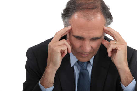 tilted view: Man with headache Stock Photo