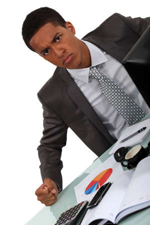 young Afro-American businessman looking irritated photo
