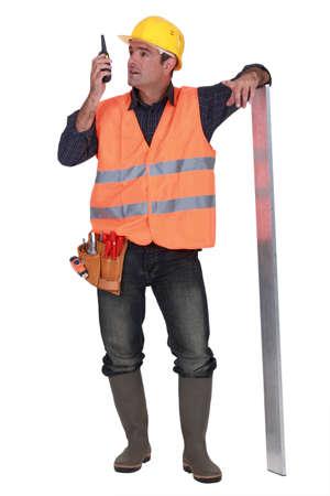 foremaster: foreman standing in studio using talkie walkie