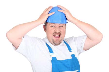 overtaken: craftsman with hands on hard hat