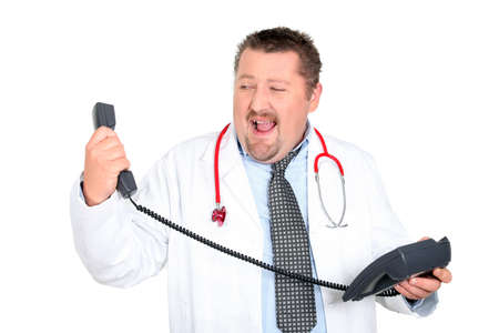 delirious: Angry doctor holding telephone