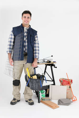 Manual worker surrounded by equipment Stock Photo - 15448560