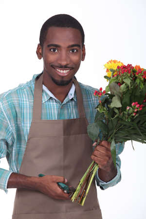 florist with bouquet of flowers on white background Stock Photo - 15448479