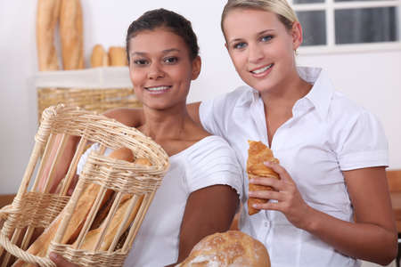 bakery shop: Two young women working in a bakery