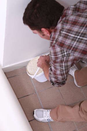 tilted view: Oblique image of a man laying carpet Stock Photo