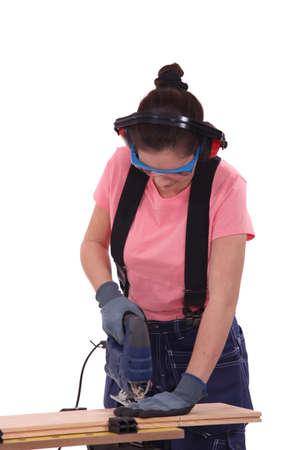 Safety conscious female carpenter photo