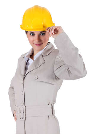 Woman with gray suit and yellow helmet photo