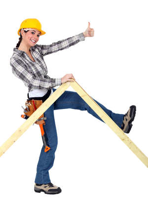 peppy: Peppy woman holding up a wooden frame Stock Photo