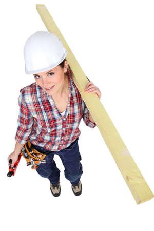 craftswoman: craftswoman holding a wooden piece
