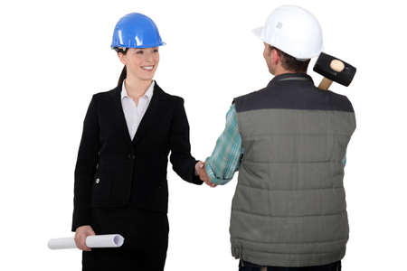 craftsman and businesswoman shaking hands photo
