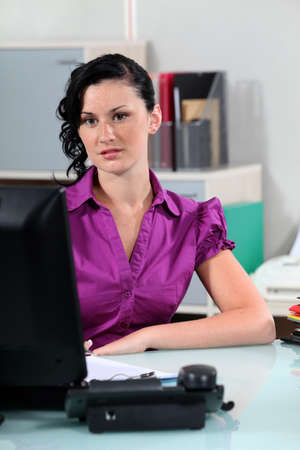 secretary desk: young secretary working at her desk