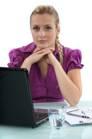 emotionless: Woman working on her laptop Stock Photo