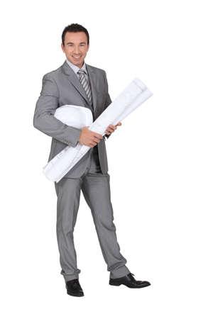 manufactory: Smiling entrepreneur on white background
