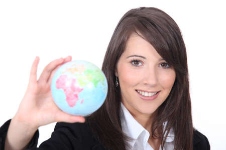 foreign: Young smart woman holding the world in her hand