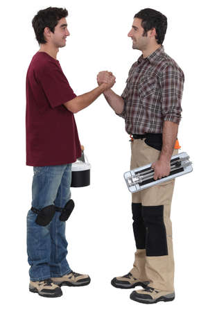 Two decorators greeting each other Stock Photo - 15448546