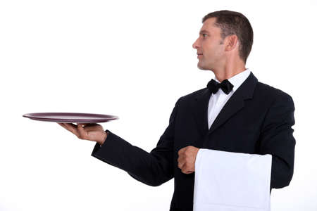 serve one person: A waiter holding an empty tray