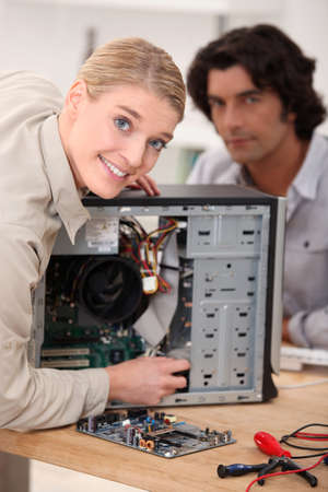 Couple attempting to repair computer photo