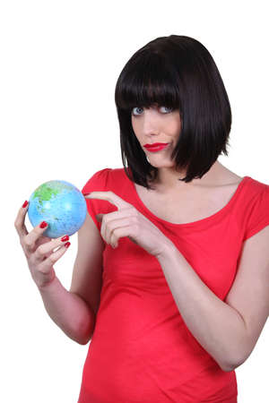 woman holding a globe and making a funny face Stock Photo - 15448529