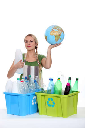 international recycle symbol: Woman recycling plastic bottles to protect planet earth