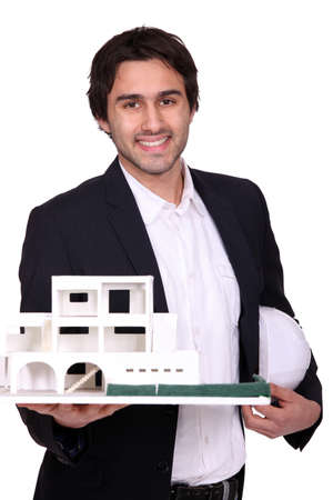 Architect holding scale model of housing photo